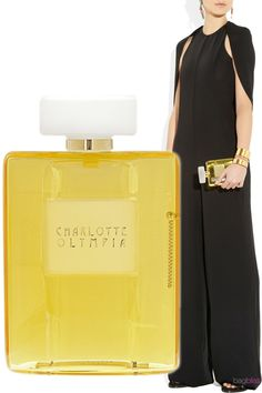 Charlotte Olympia's latest collection is inspired by Paris. Updating her signature Perspex clutch in the shape of of a classic perfume bottle, this unique design captures designer Charlotte Dellal's romantic vision.