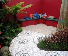 foto diseño jardin minimalista con sendero de piedra de rio