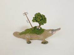 Sekai, Japanese for 'world', is a series of clever sculptures by Maico Akiba, in which tiny little worlds emerge on the backs of wooden animals. The sculpt
