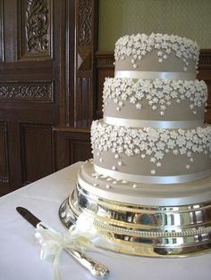Silver Wedding Cake - LOVE the little flowers! Its perfect and simple!