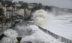 Waves crash against the seafront and the railway line that has been closed due to storm damage at Dawlish.
