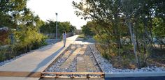 Stormwater runoff is diverted at South Field into carefully crafted sediment forbears of native limestone. -- Phil Hardberger Park | San Antonio, TX | Stephen Stimson Associates Landscape Architects | 2015 ASLA Award