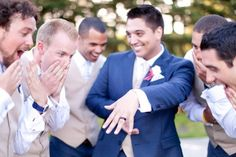 Hilarious photo idea for the groom and groomsmen. The guy has to show off his ring too you know!!