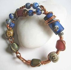 Wire wrapped copper african trade bead bracelet by ColganDesigns, $32.50