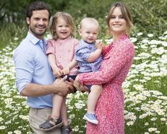 """Yesterday, Prince Carl Philip and Princess Sofia shared on their official Instagram account a new family photo showing the couple together with their children, Prince Alexander and Prince Gabriel, with the message """"We wish you a really nice summer!"""". (Princess Sofia is wearing a byTimo cotton organza petite flowers shirt dress.)"""
