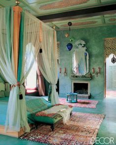 Nightclub owner Jaouad Kadiri creates a majestic yet laid-back home in Marrakech with the help of Stuart Church. Shimmering silks adorn a grand bed in the Jade Room; Church designed the Venetian-style mirror, which was made by Tangerine craftsmen.