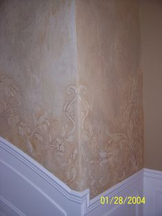 Custom designed stencil and raised plaster work for a curved stairway wall by Tracy Wade Design, LLC.