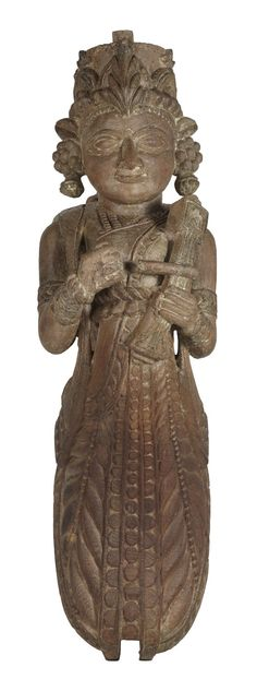 This carved wood female musician  is holding a #sarangi,  is originally a strut from a pillar of a wood mansion from north-western India. The figure can be identified as #apsara, the divine dancer and musician of Indian Mythology.#Gujarat, #19thCentury