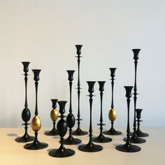 biedermeier candlestick collection in oxidized bronze. ted muehling