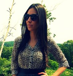 Leopard blouse + black leather skirt + black shades.