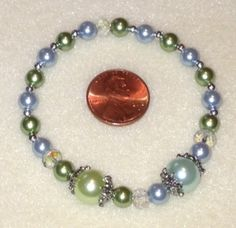 Stretch bracelet with March and August birthstone bracelet with glass pearls, clear AB rondells, silver bead caps, silver spacer beads $15