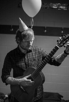 What a cutie!  Ed, the birthday boy (man), tuning his guitar.   ~Photographer Mark Surridge~