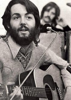 Paul, and Ringo in the background, during Let It Be sessions, January 1969.