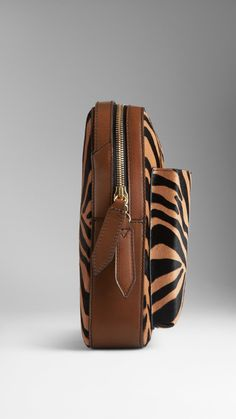 Small Striped Animal Print Crossbody Satchel | Burberry $1,550.00 Item 38949541 CAMEL         A structured crossbody satchel crafted from striped animal print calfskin.         Designed with an external moulded pocket for an iPad Mini, the bag features a double zip closure and an adjustable shoulder strap.         Grosgrain lining and hand-painted edges complete the clean design.         20.5 x 27 x 5cm         8.1 x 10.6 x 2in         100% calfskin with leather trim         Made in Italy