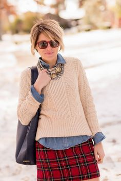 Get this classic preppy look by adding a collar underneath a cable knit Gap sweater. Blogger Seersucker + Saddles mixes in a plaid print for a festive twist. Shop wardrobe staples like this sweater at Gap.