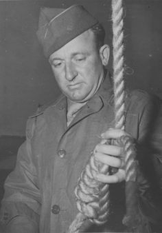 U.S. Master Sergeant John Woods preparing a noose for one sentenced at Nuremberg. Woods carried out the executions of ten former top leaders of the Reich following their sentences at the Nuremberg Trials.
