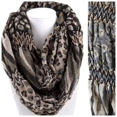 "B11 Textured Ruffle Puffy Brown Infinity Scarf ‼️ PRICE FIRM UNLESS BUNDLED WITH OTHER ITEMS FROM MY CLOSET ‼️  Textured pucker fabric with animal print pattern.  Beige, brown & black.  100% polyester.   Please check my closet for many more items including jewelry, shoes, handbags designer clothing & more!   Length 29""  Width 11""  Lots of stretch to this fabric!  Soft and wonderful! Boutique Accessories Scarves & Wraps"
