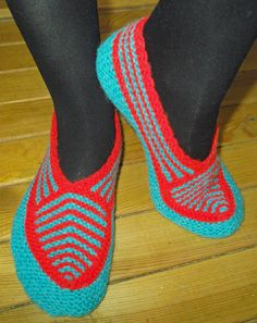 Hand knitted female slippers made of lamb wool and acrylic - blue with red pattern.