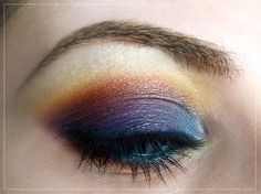 Sunset eye look - blue, purple orange with blue eyeliner in the waterline.