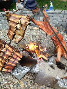 Piggy and beef rib racks 'al asador' for memorial day in Rochester, NY. People associate 'al asado' with Francis Mallman but in Argentina they've been grilling over open fire and on a cross for a hundred years on the farms. #Contest