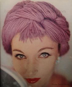 Evelyn Tripp is wearing a violet twisted yarn hat-wig from Bloomingdale's, Apple-on-a-stick lipstick by Dorothy Gray, photo by Karen Radkai, Vogue, September 1958 Yarn Wig, Wig Hat, Vogue Editorial, Vintage Fashion Photography, Love Hat, Doll Hair, Fashion Dolls, Fashion Mag, High Fashion