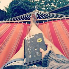 Books and Hammocks are a must in my life . #relax #read #librarybook #thehuntforvulcan #thomaslevenson #hammocklife #evening #grayclouds by @rosaposapie