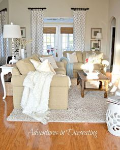 Tan and white living room Love the curtains and splashes of light blue