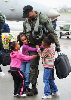 Daddy's home! (...and who cares if he can't walk with all those happy girls hanging on!)