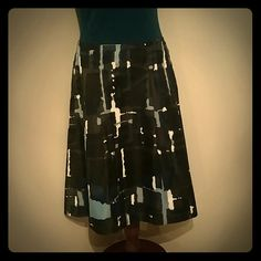 Patterned knee-length skirt Express skirt, worn once. Polyester. Black with blue, teal, and white patterns.  Has a gold zipper in the back. Express Skirts Midi