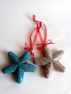 Stars in crackle white and turquoise Raku glaze with red ribbon- approx 9 cm