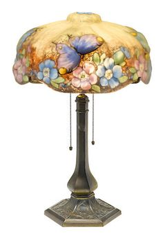 A Pairpoint reverse painted puffy glass and patinated metal Butterflies and Apple Blossoms table lamp 1900-1925