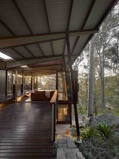 This timber house responds to the challenges of remote building on an island north of sydney, on a steep, bush site. The site is on a western slope, access