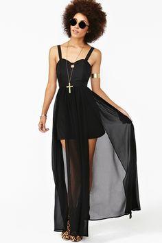 Flowy black maxi dress featuring a cutout neckline and split chiffon skirt.