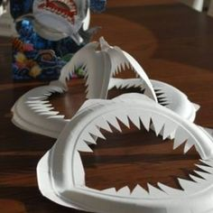 Paper Plate Shark Jaws {Easy Craft}This cute and clever paper plate craft is an easy craft to make anytime. This craft is perfect for little ones who are obsessed with sharks, or to decorate a shark themed party. Sting a set of shark jaws together for a strikingly unique garland.View This Tutorial