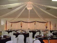 Ceiling draping: white tulle & lights, & Chandelier