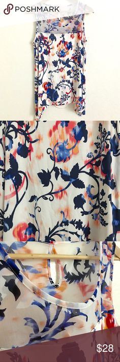 Dana Buchman Floral Vine  Keyhole Sleeveless Top Great Condition except from the Size Tag • Sheer  on the top area • Spandex • Back Keyhole • Perfect in any occasion  Measurement when laid flat:  (approx) Pit-Pit 16.5 Length 27 inches Dana Buchman Tops