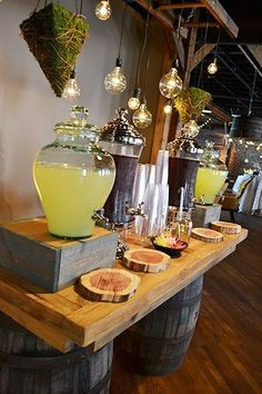 Drink station - would be wonderful in a rustic barn setting wedding. I like the idea of the wood slabs. I have those drink containers with the lemonade in them. They are from Costco