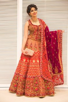 corset blouse , bridal lehenga, ornate, heavy , all over embroidery, red and bronze, gold, wine colored dupatta, rose detailing, sleeveless, front open, rich, mughal, all over, heavy
