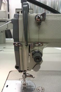 Learning how to thread an industrial sewing machine