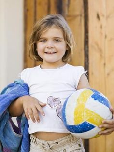 Give the kids a balloon to practice proper serving techniques. Balloons keep learning fun and allow the youngsters to focus on arm control.