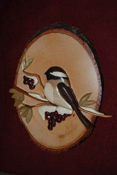intarsia chickadee on branch w/ berries & snow(facing forward). $60.00, via Etsy.