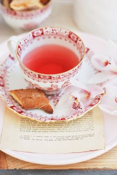 Tea. Beautiful deep-rose-pink against white tea cup saucer.