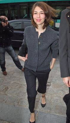 Sofia Coppola in a grey cardi - fake it with slouchy black BCBG pants and a grey sweater. And I want these flats. More