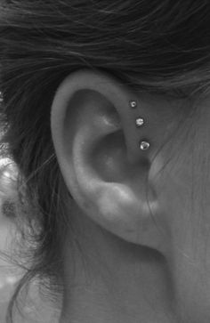Triple forward helix...This is freaking adorable!! I just don't know if I have the balls to pull it off... I'm all about symmetry so I'd want both ears done.