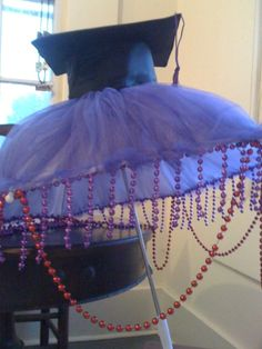 This second line umbrella was created for a high school graduation party, whose guest of honor loved purple and red!  Created by All About Events www.allaboutevents.net
