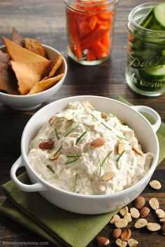Roasted Garlic and Almond Dip - A creamy yet healthy dip made with Greek yogurt, roasted garlic, Parmesan cheese and crunchy almonds. Perfect to take to a party, pack in your lunch, or spread on a sandwich or burger. | foxeslovelemons.com