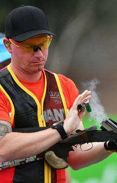 Germany's Andreas Loew competes in the men's double trap qualification during the Rio 2016 Olympic Games at the Olympic Shooting Centre on Aug. 10, 2016.   Best Photos From The Rio Olympics