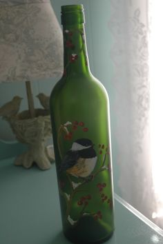 Single chickadee - hand painted wine bottle with lights.  SOLD