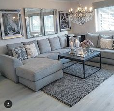I like the gray couch with the two mirrors for the family room
