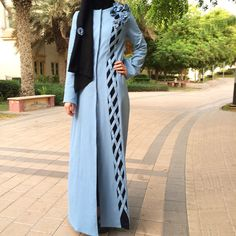 Sporty or romantic? Both! Our Denim Criss-Cross Abaya featuring hand-made denim flowers